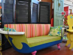 Another old, forgotten tub was turned into a cool couch. Retro colors and patterns give it an eclectic, vintage vibe.
