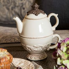 No need to make more than you need! This smart ceramic piece puts the cup and the teapot together for the perfect personal spot of tea. A feminine design enrobes the combo and a metal finial tops the ...