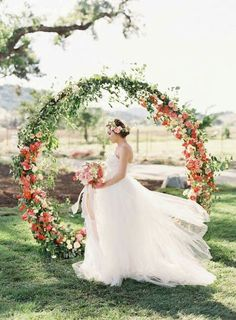 orange wedding floral backdrop / http://www.deerpearlflowers.com/wedding-ceremony-arches-and-altars/3/