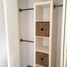 custom IKEA-hack closet: a painted Expedit bookcase & woven grass baskets for shoe, handbag & folded clothing storage with Antique Brass spray-painted industrial steel rods & flush mounts from Home Depot for hanging clothes (IG MelissaMassello)