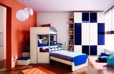 Kids Bedroom New Trend in Boys Bedroom Designs with Bunk Bed: Boys Bedroom With Laminated Wood Floor Glass Door Blue Accented Stair Bunk Bed Circle Pendant Light Big Bookcase Four Door Wardrobe Interior Shutter