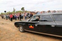 Hearse carries Mungo Man's remains