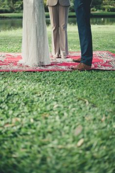 Antique rugs for ceremony // photo by Trigger Happy Images