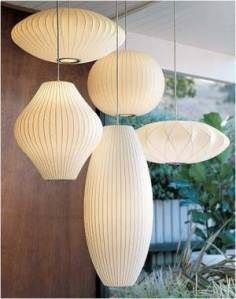 George Nelson Bubble Pendants. I have the cigar pendant, waiting for the Saarinen Tulip Table to be delivered for under it. And Cigar Lamp night table lamps. LOVE!!!