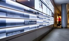 The hospital's stories are displayed on five 40-in. NEC 400UX-3 LCD monitors embedded in the wall and surrounded by arrays of 8-foot-long by 6-inch-high acrylic strips that slide into horizontal, extruded-aluminum channels. #SEGD