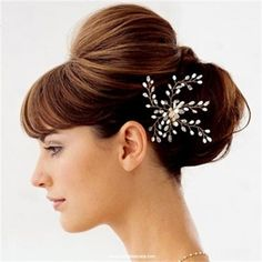 Check out Wedding hairstyles low bun. We watch out for the best hairstyle trends and curate it for you. Don't miss out on the latest hairstyles of 2014.