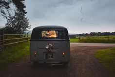 VW camper van wedding photography - Danni & Jamie leave in style for their DIY village hall wedding reception.