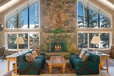 Fireplace between windows.