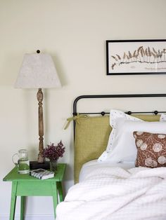 Like the cushion/pillow tied to the iron headboard. COTTAGE AND VINE: Carrier and Company Positively Chic Interiors