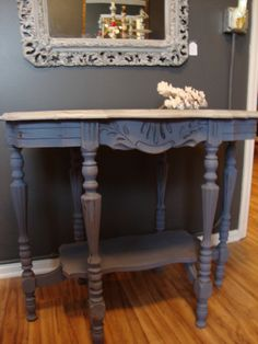 This Victorian spoon carved table was painted in Paris gray and old violet and then distressed.