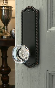 Emtek door hardware in crystal and chrome for hallway closet