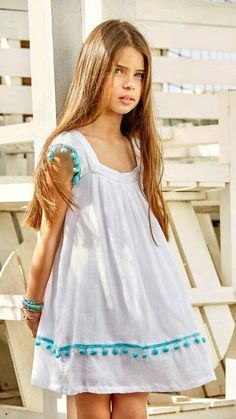 Flowing white dress, turquoise tassels at sleeves & above the hem. The anytime dress for girls, juniors, teens. Little Girl Dresses, Girls Dresses, Kids Outfits, Cute Outfits, Girl Dress Patterns, Kids Wear, Cute Dresses, Maxi Dresses, Baby Dress
