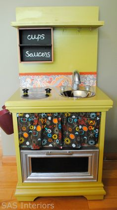 this is one of the cutest things ever.  and i love repurposed furniture!  a nightstand into a child's play kitchen.  genius.  i've also seen this done with a child's desk.