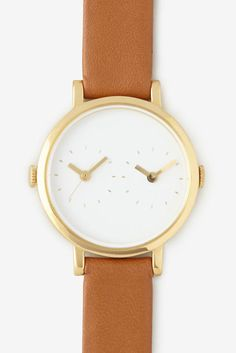 Because she doesn't want to do the time zone math to figure out whether it's too early to call. Time traveler watch ($385) by Steven Alan Watches, stevenalan.com