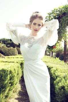 Fitted draped dress, sweetheart neckline with sheer overlay high necked top, cutouts backed with lace, long puffed sleeves, Victorian influence