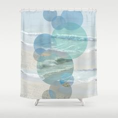 Shoreline and wave photography have been combined with geometric shapes to make this unique curtain. This fascinating design will be a great