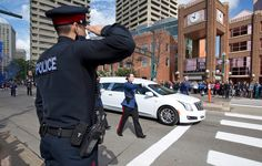 An officer salutes the hearse transporting Daniel Woodall's casket draped with Canada's Maple Leaf flag Support Law Enforcement, Law Enforcement Officer, Son In Law, To My Daughter, I Am Canadian, The Line Of Duty, National Police, United We Stand, Thin Blue Lines