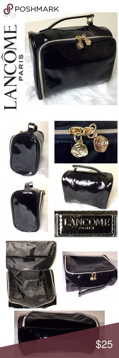 """Lancôme Signature Travel Cosmetic Bag Lancôme Signature Travel Cosmetic Bag, Beautiful Black Vinyl with Gold Hardware, Very Spacious for all your toiletries, Approx. Size is: 8 1/2""""x 6 1/2""""x 4"""", NWOT! Lancome Bags Cosmetic Bags & Cases"""