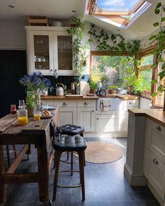 My favourite spot when the sun is shining! Im waiting for my grocery shop to arrive as these croissants are not helping with the wine head from last night! Show me all the bacon   #kitchendesign #kitchendecor #farmhousekitchen #shakercabinets #shakerkitchen #kitchensofinstagram #styleinspired #styleithappy #happyhome #farmhousedecor #rustickitchen #homeblog #interiors #interieurinspiratie #interieur #kitchenideas #homeinspo #interior_and_home #kitchenisland #plantsmakepeoplehappy #urbanjungleblo
