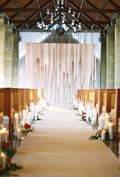 Line your aisle runner with taper candles for a romantic effect | Brides.com