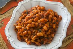KATHY'S BAKED BEANS. 2 cans (1 lb.) baked beans or pork&beans, 1 cup grated sharp cheddar cheese, 2 T light brown sugar, 2 t parsley flakes, ¼ t garlic salt, 1 can (3 oz) French fried onion rings. Mix first five ingredients.  Stir in ½ can of onions.  Pour into 1½ quart casserole.  Bake 350/25 min.  Put remaining onions on top.  Bake 5 minutes longer.  Serves 6. I make this ahead & bring out 1 hour before putting into oven.  Be sure beans are bubbly before putting on the last onions for…