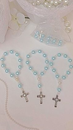 Items similar to A DOZEN Light Blue glass pearl mini rosary bracelets. Perfect for first communions, baptisms, and wedding favors. on Etsy Communion Favors, Rosary Bracelet, Baby Baptism, Dog Tattoos, First Communion, Diy Projects To Try, Cross Pendant, Mini, Wedding Favors