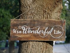 It's a Wonderful Life. For me, this is the movie that says Christmas. I've wrapped many a present while watching this movie. It's a Wonderful Life -Rustic Wooden Sign for Holiday or Year-Round Use, Distressed Wood with White Vinyl Letters, and Protective Gloss Coat www.etsy.com/... #itsawonderfullife, #deckallthehalls