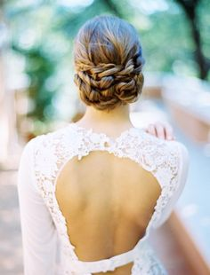 We're loving this twisted updo created by Samantha Landis. Photo by Ben Q. Photography. #wedding #beauty #hair #updo