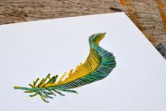 stitched feather