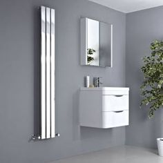 Create a warm and cosy bathroom with this chrome vertical radiator