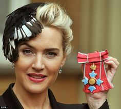 Kate Winslet wears a black and white feathered hair piece as the Queen awards her with a prestigious CBE    Read more: http://www.dailymail.co.uk/tvshowbiz/article-2236316/Kate-Winslet-discusses-motherhood-Queen-shes-awarded-prestigious-CBE.html#ixzz2Crun6COb  Follow us: @MailOnline on Twitter | DailyMail on Facebook
