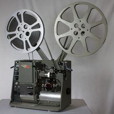 Fond memories of watching reel-to-reel movies in class.  It seems like the film would ALWAYS stop and every class had that 1 kid that could always fix it.