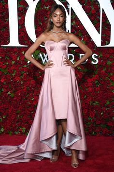 Jourdan Dunn is all elegance in at the 2016 Tony Awards in a rose colored mullet hem dress by Zac Posen.