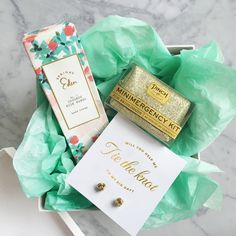 Propose to your bridesmaids-to-be with this thoughtful box of treats: Minimergency for Bridesmaids, indulgent hand lotion, and some bling!