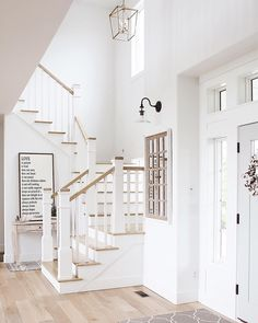 Niña and Cecilia (@ninaandcecilia) on Instagram - white foyer and staircase coastal farmhouse style