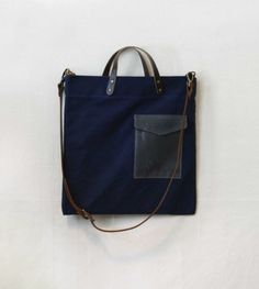 Navy blue crossbody bag, not sure who made it, but I love the dark leather trim, studs and pocket.