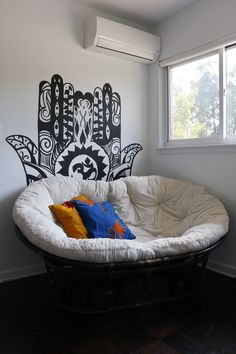 The painted Hamsa hand by artist Verna Fogg introduces a meditative element into Jhettes room. African Pillows: Le Noir Home. Room Ideas Bedroom, Small Room Bedroom, Bedroom Decor, Small Rooms, Decor Room, Room Decorations, Papasan Cushion, Double Papasan Chair, Couple Bedroom