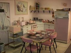 Pink retro kitchen. My late grandma had the exact same Formica dinette set: