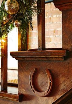 Alison nailed dinged-up horseshoes to the sides of the staircase. House Tour: Deck the Stalls | Midwest Living