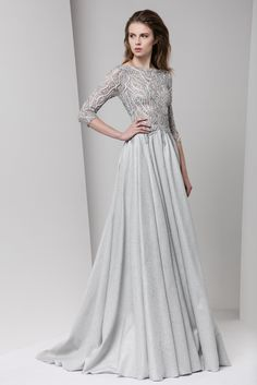 Silver A-line evening dress with boat neckline and ¾ sleeves, featuring a Jacquard lurex skirt and an embroidered bust.