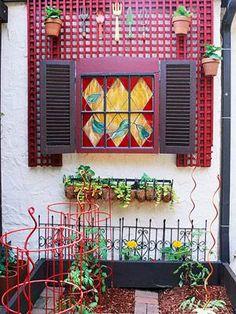 whimsical garden window.  I like the idea of creating a fake window. :)