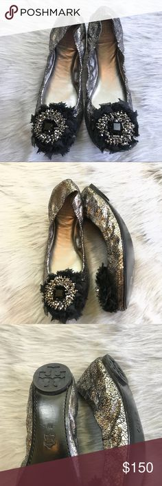Tory Burch Amelia flat size 8M metallic RARE Silver-tone metallic leather Tory Burch round-toe flats with black jewel embellishments at tops and rubber soles. Shoes do not include box but they are practically new the souls have absolute no wear Tory Burch Shoes Flats & Loafers