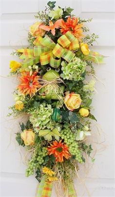 Spring swag  http://www.timelessfloralcreations.com/