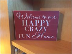 "Picture of an art piece that says: ""Welcome to our happy crazy fun HOme 