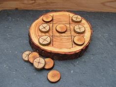 tic tac toe on a wood slice.