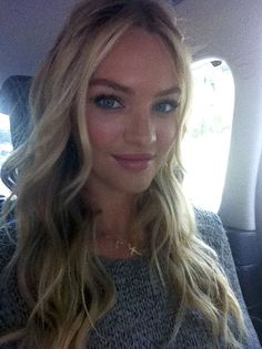 Candice Swanepoel. Wavy beach hair and gorgeous make up