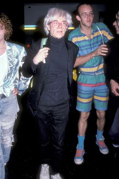 Keith Haring and Andy Warhol make an entrance at Mick Jagger's 42nd birthday party at the Palladium, 1985