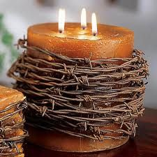 Wraps Barbed wire candle for centerpieces? Maybe not as much barbed wire and a white candle.Barbed wire candle for centerpieces? Maybe not as much barbed wire and a white candle. Western Decor, Country Decor, Rustic Decor, Western Crafts, Western Theme, Rustic Outdoor, Country Charm, Western Style, Wire Font