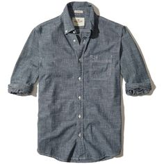 Hollister Button-Front Chambray Shirt ($15) ❤ liked on Polyvore featuring men's fashion, men's clothing, men's shirts, men's casual shirts, men tops/outerwear, navy, mens curved hem t shirt, mens slim shirts, mens navy blue shirt and mens slim fit shirts