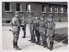 """2 no caption.  Unidentified German soldiers or maybe RAD (REICHSARBEITSDIENST). Basically, men who were trained as a para-military force with picks and shovels for """"shovel ready projects"""" that Hitler and ORGANIZATION TODT had planned like the autobahns and building projects."""